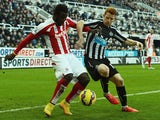 Mame Biram Diouf of Stoke City and Jack Colback of Newcastle United battle for the ball during the Barclays Premier League match between Newcastle United and Stoke City at St James' Park on February 8, 2015