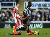Moussa Sissoko of Newcastle United is tackled by Steven N'Zonzi of Stoke City during the Barclays Premier League match between Newcastle United and Stoke City at St James' Park on February 8, 2015