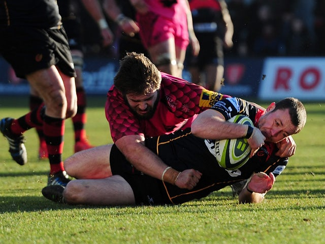 Richie Rees of the Dragons goes over for his side's first try during the LV= Cup match between Newport Gwent Dragons and London Welsh at Rodney Parade on February 8, 2015