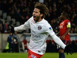 Paris Saint-Germain's Brazilian defender Maxwell celebrates after scoring a goal during the French League Cup football match Lille vs PSG on February 3, 2015
