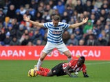 Queens Park Rangers' English defender Clint Hill vies with Southampton's Senegalese midfielder Sadio Mane during the English Premier League football match between Queens Park Rangers and Southampton at Loftus Road Stadium in London, on February 7, 2015