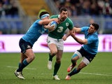 Rob Kearney of Ireland is tackled by Luca Morisi of Italy and Edoardo Gori of Italy during the RBS Six Nations match between Italy and Ireland at the Stadio Olimpico on February 7, 2015