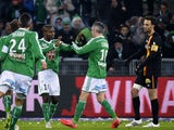 Saint-Etienne's Cameroonian forward Landry N'Guemo celebrates with St Etienne's French midfielder Fabien Lemoine after scoring a goal during the French L1 football match AS Saint-Etienne (ASSE) vs Racing Club Lens (RCL) on February 6, 2015