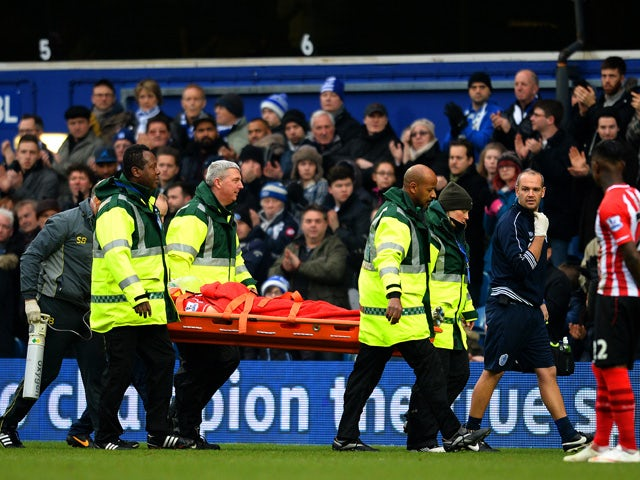 Matt Targett of Southampton is stretchered off during the Barclays Premier League match between Queens Park Rangers and Southampton at Loftus Road on February 7, 2015