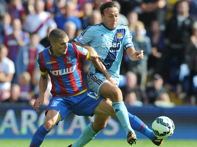 Crystal Palace's English midfielder Stuart OKeefe vies with West Ham United's English midfielder Mark Noble (R) during the English Premier League football match between Crystal Palace and West Ham United at Selhurst Park in south London on August 23, 2014