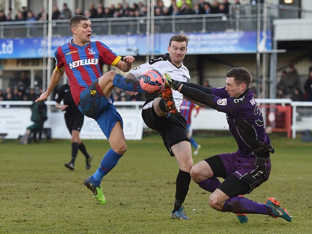 Tom Bonner and Andrew Rafferty of Dover block a shot by Stuart O'Keefe of Palace during the FA Cup Third Round match between Dover Athletic and Crystal Palace on January 4, 2015