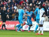 Jermain Defoe of Sunderland celebrates scoring the opening goal with team mates during the Barclays Premier League match between Swansea City and Sunderland at Liberty Stadium on February 7, 2015