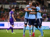 Marc Janko, Milos Dimitrijevic and Alex Brosque of Sydney celebrate a goal during the round 16 A-League match between the Perth Glory and Sydney FC at nib Stadium on February 7, 2015