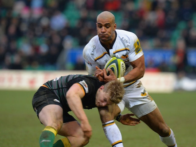 Tom Stephenson of Northampton Saints tackles Tom Varndell of Wasps during the LV= Cup match on February 7, 2015