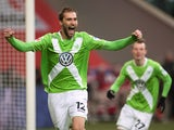 Wolfsburg's forward Bas Dost of the Netherlands celebrates scoring the opening goal during the German first division Bundesliga football match VfL Wolfsburg vs 1899 Hoffenheim in Wolfsburg, central Germany, on February 7, 2015