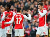 Alexis Sanchez congratulates Olivier Giroud after the Frenchman scores Arsenal's opener on February 15, 2014