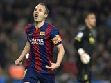 Barcelona's midfielder Andres Iniesta celebrates after scoring a goal during the Spanish Copa del Rey (King's Cup) semifinal first leg football match against Villarreal on February 11, 2015