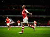 Theo Walcott of Arsenal celebrates after scoring his team's second goal during the Barclays Premier League match between Arsenal and Leicester City at Emirates Stadium on February 10, 2015