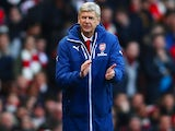 Arsenal manager Arsene Wenger applauds while wearing his ridiculously oversized coat on February 15, 2015