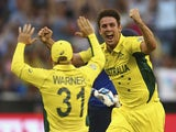 Mitch Marsh of Australia celebrates after taking the wicket of Joe Root of England during the 2015 ICC Cricket World Cup match between England and Australia at Melbourne Cricket Ground on February 14, 2015