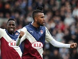 Bordeaux's Swedish forward Isaac Kiese Thelinand Bordeaux's Gabonese midfielder Andre Biyogo Poko celebrate at the end of the French L1 football match between Girondins de Bordeaux (FCGB) and Saint-Etienne (ASSE) on February 15, 2015