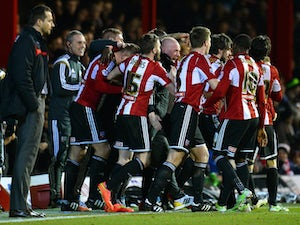 Andre Gray of Brentford FC celebrates scoring the first goal with Mark Warburton Manager of Brentford FC during the Sky Bet Championship match between Brentford and Watford at Griffin Park on February 10, 2015