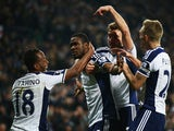 Brown Ideye of West Brom celebrates scoring the opening goal with team mates during the Barclays Premier League match against Swansea City on February 11, 2015
