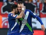 Wolfsburg's midfielder Daniel Caligiuri (L) and Wolfsburg's Dutch striker Bas Dost celebrate during the German first division Bundesliga football match against Bayer 04 Leverkusen on February 14, 2015