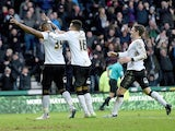 Darren Bent of Derby is congratulated after scoring during the FA Cup fifth round tie between Derby County and Reading at iPro Stadium on February 14, 2015