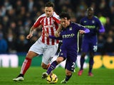 David Silva of Manchester City battles for the ball with Marko Arnautovic of Stoke City during the Barclays Premier League match on February 11, 2015