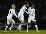 Thomas Ince of Derby County celebrates with Richard Keogh and Will Hughes as he scores their first and equalising goal during the Sky Bet Championship match between AFC Bournemouth and Derby County at Goldsands Stadium on February 10, 2015
