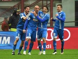 Empoli's forward Massimo Maccarone celebrates with teammates after scoring a goal during the Italian Serie A football match between AC Milan and Empoli at San Siro Stadium in Milan on February 15, 2015