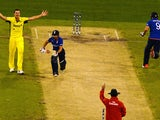 Umpire Aleem Dar (bottom) raises his finger to give England's batsman James Taylor (L) out lbw out as James Anderson (R) fails to gain his ground and later declared run out during the Pool A 2015 Cricket World Cup match between Australia and England at th