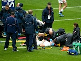 Mike Brown of England lies injured on the pitch during the RBS Six Nations match between England and Italy at Twickenham Stadium on February 14, 2015