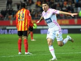 Evian's French forward Mathieu Duhamel jubilates after scoring during the French L1 football match between Lens and Evian Thonon on February 14, 2015