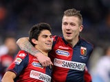 Diego Perotti with his teammate Juraj Kucka of Genoa CFC celebrates after scoring the opening goal from penalty spot during the Serie A match between SS Lazio and Genoa CFC at Stadio Olimpico on February 9, 2015
