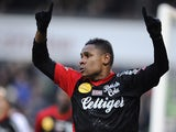 Guingamp's French forward Christophe Mandanne celebrates after scoring during the French L1 football match Metz against Guingamp at Saint Symphorien stadium on February 15, 2015