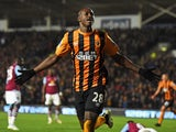 Dame N'Doye of Hull City celebrates after scoring is team's second goal during the Barclays Premier League match between Hull City and Aston Villa at the KC Stadium on February 10, 2015