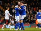 Daryl Murphy of Ipswich Town (C) celebrates with teammates Freddie Sears (L) and Christophe Berra (R) after scoring his second goal during the Sky Bet Championship match between Fulham and Ipswich Town at Craven Cottage on February 14, 2015