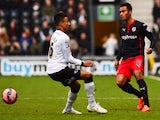 Jordan Obita of Reading takes on Jesse Lingard of Derby County during the FA Cup Fifth Round match between Derby County and Reading at iPro Stadium on February 14, 2015