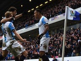 Blackburn's Norwegian striker Joshua King (R) celebrates with teammates after scoring his third and the team's fourth goal during the English FA Cup fifth round football match against Stoke on February 14, 2015
