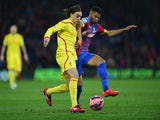 Lazar Markovic of Liverpool and Fraizer Campbell of Crystal Palace battle for the ball during the FA Cup fifth round match on February 14, 2015