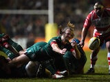 Sam Harrison of Leicester dives to pass during the Aviva Premiership match between Leicester Tigers and Gloucester Rugby at Welford Road on February 13, 2015
