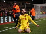 Liverpool's English midfielder Adam Lallana celebrates after scoring their second goal to take the lead 2-1 during the English FA Cup fifth round football match between Crystal Palace and Liverpool at Selhurst Park in south London on February 14, 2015