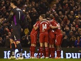 Liverpool players celebrate after Liverpool's Serbian midfielder Lazar Markovic scored the opening goal during the English Premier League football match between Liverpool and Tottenham Hotspur at the Anfield stadium in Liverpool, northwest England, on Feb