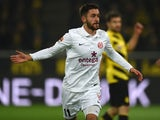 Mainz' midfielder Yunus Malli celebrates after scoring a second goal during the German first division Bundesliga football match Borussia Dortmund v 1 FSV Mainz 05 in Dortmund, Germany, on February 13, 2015