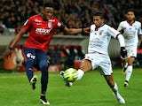 Nice's Malagasy defender Albert Rafetraniaina vies for the with Lille's Belgian forward Divock Origi during the French L1 football match between Lille (LOSC) and Nice (OGCN) on February 14, 2015