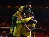Jonathan Howson of Norwich celebrates scoring the opening goal with team mates during the Sky Bet Championship match between Charlton Athletic and Norwich City at The Valley on February 10, 2015