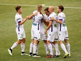 Perth Glory players celebrate after scoring during round 17 A-League match between Adelaide United and Perth Glory at Coopers Stadium on February 15, 2015