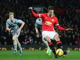 Robin van Persie of Manchester United scores from the penalty spot during the Barclays Premier League match against Burnley on February 11, 2015