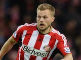 Sebastian Larsson of Sunderland goes past the challenge from Alexandre Song of West Ham during the Barclays Premier League match on December 13, 2014