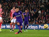 Sergio Aguero of Manchester City scores his team's third goal from the penalty spot during the Barclays Premier League match against Stoke City on February 11, 2015