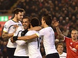 Tottenham Hotspur's Belgian midfielder Mousa Dembele is surrounded by team-mates after scoring their second goal to equalise 2-2 during the English Premier League football match between Liverpool and Tottenham Hotspur at the Anfield stadium in Liverpool,
