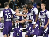 Toulouse's Italian-Argentinian midfielder Oscar Trejo celebrates with teammates after scoring a goal during the French L1 football match between Toulouse and Rennes at the Municipal Stadium in Toulouse on February 14, 2015