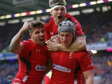 Wales's centre Jonathan Davies celebrates scoring a try with Wales's scrum half Rhys Webb during the Six Nations international rugby union match between Scotland and Wales at Murrayfield in Edinburgh on February 15, 2015